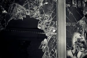 black and white picture of shattered window glass